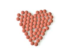 Heart Pattern in Pink Pills. Pink tablets in the pattern of a heart Stock Photos