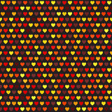 Heart pattern. Vector seamless background. Maroon, red, orange, gold, yellow hearts on black backdrop Royalty Free Stock Image