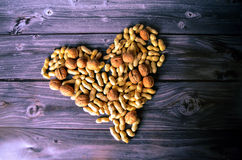 Heart of peanuts. A Heart of peanuts and walnuts Royalty Free Stock Photos