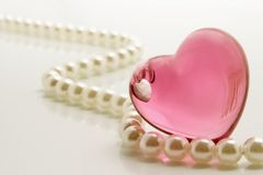 Heart and pearls. White pearls necklace and heart shape jewelry Stock Images