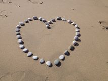 A heart of pebbles. Royalty Free Stock Image