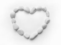 Heart pebbles frame. An unique heart or love shaped frame made up of a closely arranged ring of clean white gray pebbles.  Taken as a high key image for a light Stock Photos