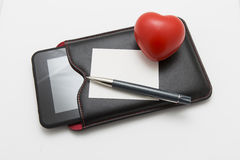 Heart with pen and tablet Royalty Free Stock Images