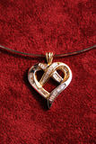 Heart Pendant. Gold heart pendant with diamonds Stock Photography