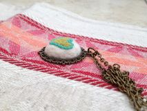 Heart Pendant. Pendant with Heart embroidery on a linen cloth Stock Image