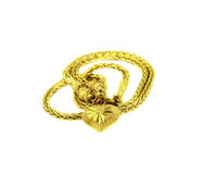 Heart pendant of gold isolated on a white. Royalty Free Stock Photography