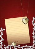 Heart pendant and pearls Royalty Free Stock Photo