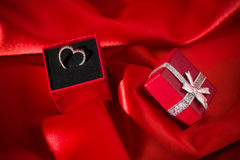 Heart pendant in a red gift box Stock Photo