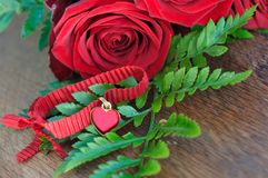 Heart pendant with roses Royalty Free Stock Photography