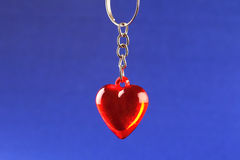 Heart pendant and silver chain. On blue background Stock Image