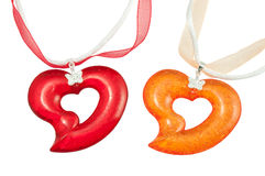 Heart pendants. Red and orange heart pendants Stock Image