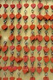 Heart pendants. Many red heart shape pendants at wall Royalty Free Stock Photos