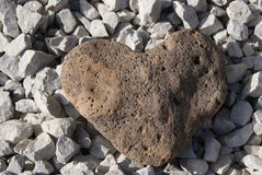 HEART. The heart is the perfect symbol for the flow of our creative life energy. This  stone heart is shape formed nature. The heart is also seen as that place Stock Image