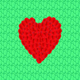Heart from petals of roses on bright green foliage Royalty Free Stock Photos