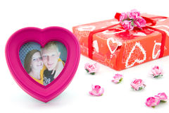 Heart photo frame with happy couple Stock Photo