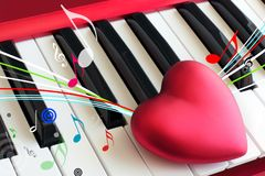Love heart on piano keyboard. Heart on the piano keys, curved lines of the musical staff, flying notes as a concept of love to music royalty free stock photos