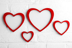 Heart picture frame on white wall Royalty Free Stock Photos