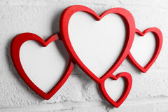 Heart picture frame on white wall Stock Photos