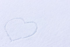Heart picture on the snow. Surface Royalty Free Stock Photography