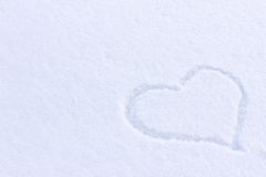Heart picture on the snow. Surface Stock Images