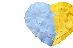 Heart of the pieces of tape. Ukrainian flag Royalty Free Stock Photo