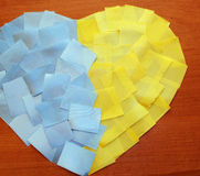 Heart of the pieces of tape. On a wooden background Ukrainian flag Royalty Free Stock Photos