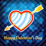 Heart pierced by an arrow on a blue background Stock Image