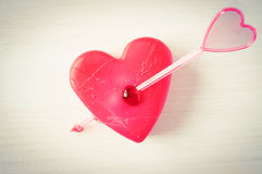 Heart pierced by an arrow. Concept wounded, broken heart pierced by an arrow Stock Image