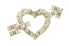 Heart pierced with arrow made of dollars. Heart pierced with arrow made of hundred dollar banknotes isolated on white background Stock Photos