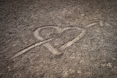 A love heart drawn in the volcanic sand of the mount Teide highland plain royalty free stock photo
