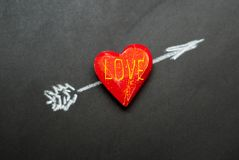 Heart pierced by an arrow Stock Photography
