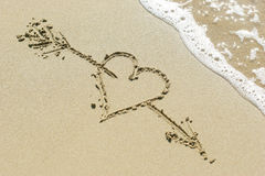 Heart pierced by Cupid's arrow. Royalty Free Stock Image
