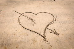 Heart pierced in the sand Royalty Free Stock Image