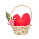 Heart pillow in basket with flower isolated on white Stock Image
