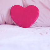 Heart pillow on the bed Stock Photo