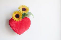 Heart pillow and daisies Royalty Free Stock Photography