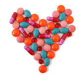 Heart from pills. Heart from milticolor pills on white background Stock Images