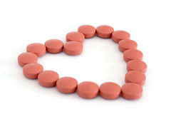 Heart of pills. Red pills or tablets, arranged in a heart shape to represent health royalty free stock photos