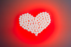 Heart pills Stock Photos