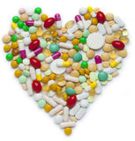Heart of pills and capsules Stock Photo