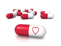 Heart pills Stock Photography