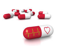 Heart pills Royalty Free Stock Image