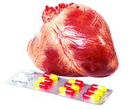 Heart with pills isolated Royalty Free Stock Photo