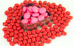 Heart of pills isolated on white background Stock Images