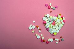 Heart and pills on a pink background medicine love. Heart and pills on pink background medicine love stock photo