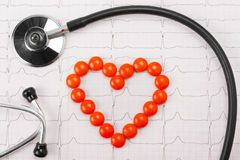 Heart of pills and stethoscope Royalty Free Stock Photography