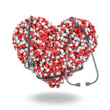 Heart pills stethoscope Stock Photos