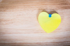 Heart pin on wooden wall background texture. Royalty Free Stock Photo