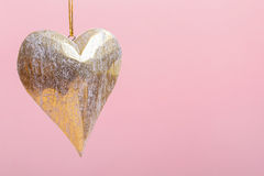 Heart on pink background Stock Images