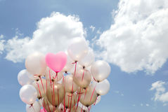 Heart pink  balloon on cloudy sky. Heart pink balloon on cloudy sky for valentine day Stock Image